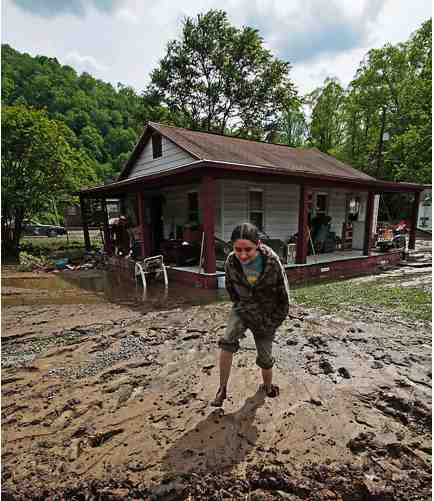 Girl walks through mud after flood, Mingo County WVa, May 09/Stephen W. Rotsch, West Virginia Governor's Office, chickahominy.davidmlawrence.com