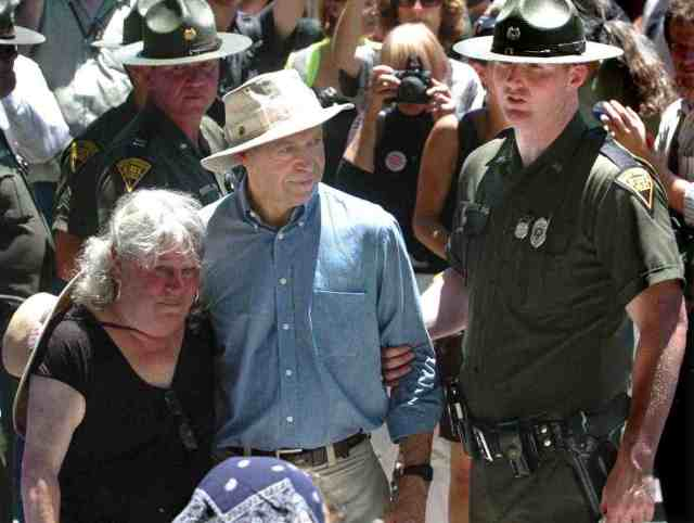 NASA climate scientist James Hansen & unidentified woman are arrested anti-MTR march & rally, Massey's Goals Coal processing plant, Sundial, WVa, June 23, 2009/ Chris Dorst, The Charleston Gazette, blogs.wvgazette.com