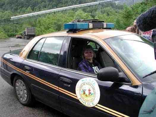 Judy is taken away by state police during march & rally at Massey's Goals Coal processing plant, Sundial, WVa, May 24, 2005/ Vivian Stockman, OHVEC, ohvec.org