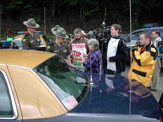 Judy Bonds is arrested for trespassing during march & rally at Massey's Goals Coal processing plant, Sundial, WVa, May 24, 2005/ Vivian Stockman, OHVEC, ohvec.org