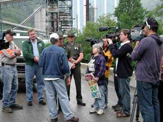 Judy Bonds & Bo Webb (back to camera) of CRMW try to deliver list of demands to Massey officials during march & rally at Massey's Goals Coal processing plant, Sundial, WVa, May 24, 2005/Vivian Stockman, OHVEC, ohvec.org
