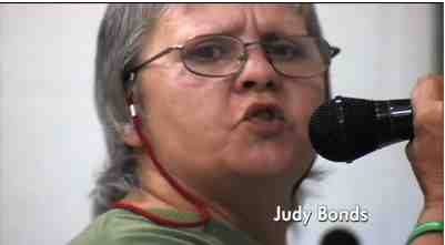"Judy Bonds speaks at local hearing concerning new Massey mining permit, image from  video tribute to Judy Bonds, excerpted from ""On Coal River""/vimeo.com"