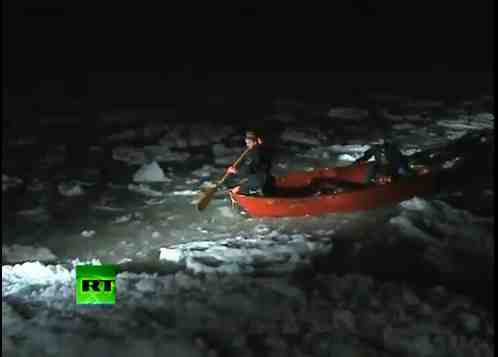 Polish firefighters paddle through ice after nightfall to rescue deer stranded on ice floe, Baltic Sea, Jan 4, 2011/Russia Today, youtube.com