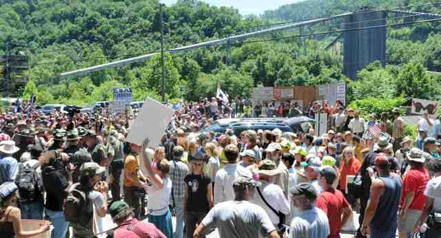 Pro & anti-MTR crowds meet at Massey's Goals Coal processing plant during anti-MTR march & ralley, Sundial, WVA, June 23, 09/Chris Dorst, The Charleston Gazette, blogs.wvgazette.com