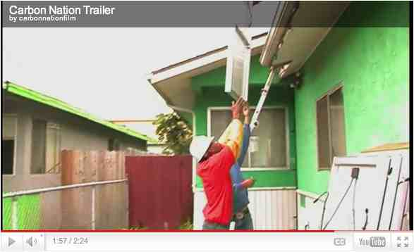 "Green job trainees install solar panels, Richmond, CA, image from trailer for ""Carbon Nation""/ carbonnationthemovie.com"