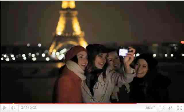Friends take a group shot as Eiffel Tower goes dark for Earth Hour, image from Earth Hour 2011 Official Video/earthhour.org, youtube.com