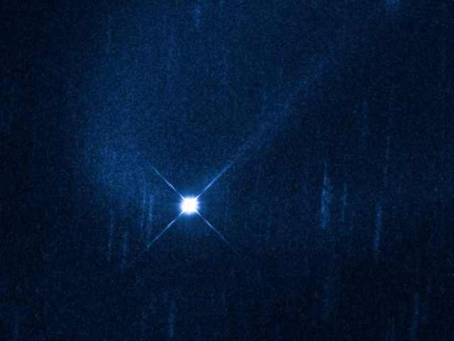 Hubble Image of Aftermath of Suspected Collision of Asteroid (596) Scheila with unidentified smaller object, December