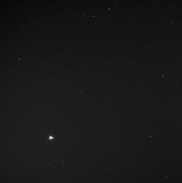 Messenger Spacecraft image of Earth and Moon from 114 million miles away, May 6, 2010/ NASA, Johns Hopkins University Applied Physics Laboratory, Carnegie Institution of Washington, messenger.jhuapl.edu