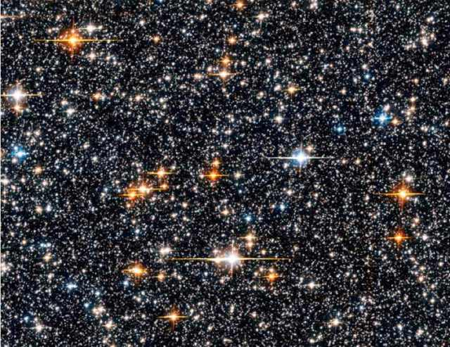 Portion of star field from Hubble Space Telescope seven-day 2006 Sagittarius Window Eclipsing Extrasolar Planet Search (SWEEPS)/ NASA, ESA, W. Clarkson (Indiana University and UCLA), K. Sahu (STScI), hubblesite.org