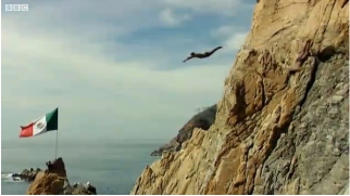 Cliff diver in mid-dive, Acapulco, undated/Video report by Rajan Datar & Jayne Douglas, BBC News