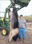 Winston Brown with 760-lb wild hog shot with crossbow west of Rush Springs, OK, Oct 13, 2011/KFOR-TV (10/14/11)