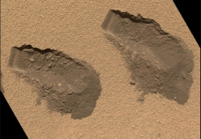 """Scoop marks, each about 1.6"""" wide, left in Martian soil by Rover Curiosity, Oct 31, 2012/NASA, Washington Post"""