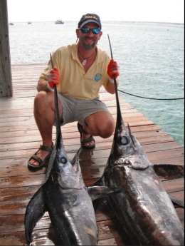 Research scientist David Kerstetter with swordfish caught in Cayman Islands in 2011, undated/David Kirstetter, Nova Southeastern University, MiamiHerald.com