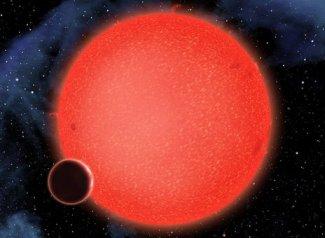 Artist's impression of Water Planet, GJ 1214b orbiting Red Dwarf Star / BBC News