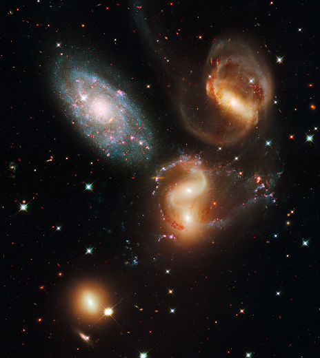 Hubble photo of new and aging stars (blue to red) and five galaxies, released Sept 9, 2009/NASA, Toronto Sun