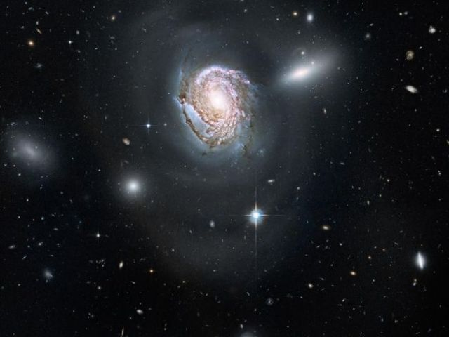 """Long-exposure Hubble image of """"Island Universe"""" galaxy system with pink hydrogen clouds, undated/NASA, Toronto Sun"""