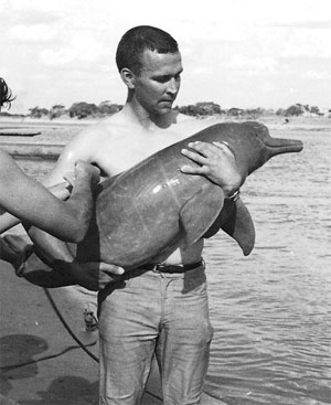 David Kenney with captured dolphin, Brazil, 1965/Kenney Family photo, Los Angeles Times