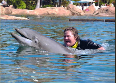 Unidentified dolphin & visitor, Discovery Cove, Orlando, FL, undated/Laurie K., Discovery Cove, discoverycove.com