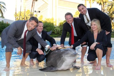 Unidentified dolphin & executives from Maritz Travel Company, at Mirage Hotel & Casino for naming of Lightning's new calf, christened MiraMar, for Mirage and Maritz, Las Vegas, Oct 12, 2011/The Mirage, etravelblackboard.us