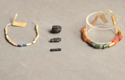 Three beads (center) hammered from meteorite metal/Rob Eagle, UCL Petri