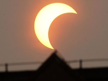 Partial eclipse, Beijing, China, May 21, 2012/Ng Han Guan, AP, USA Today