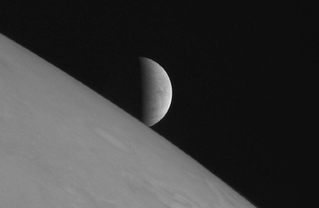 Europa rises over Jupiter/Spacecraft New Horizons, Reuters, Portland Press Herald