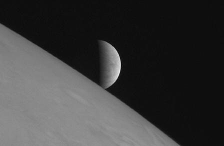 Europa rises over Jupiter/Spacecraft New Horizons, Reuters, Portland Press Herald