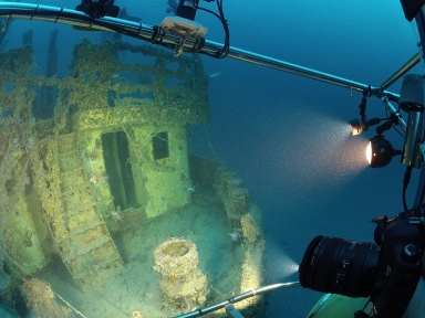 Lionfish near door of sunken ship Bill Boyd, 300 feet below surface, off Fort Lauderdale, FL, undated/Oregon State U., LiveScience.com