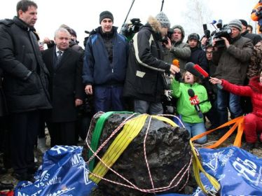Chunk of meteor that exploded over Chelyabinsk, Russia, on February 15, 2013, retrieved from Chebarkul Lake on October 16, 2013 /Alexander Firsov, AP, USA Today