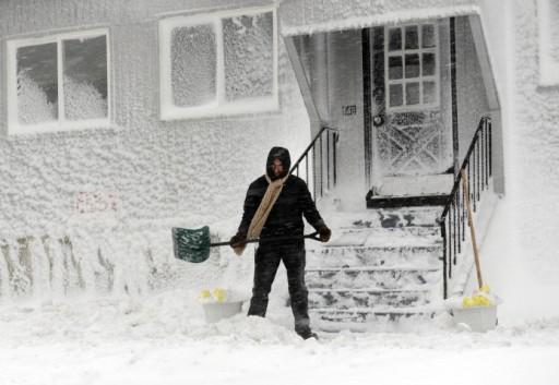Man shovels snow, Winthrop, MA, Feb 9, 2013/Darren McCollester, Getty, Time