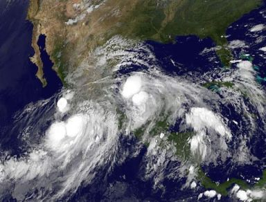 Tropical Storm Manuel in the Pacific and Hurricane Ingrid in the Gulf of Mexico converge on Mexico, Sept 15, 2013/NOAA, AP, Winnipeg Free Press
