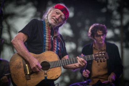 Willie Nelson and unidentified accompaniest, location and date unknown/Josh Withers, Shutterstock.com, ecorazzi.com