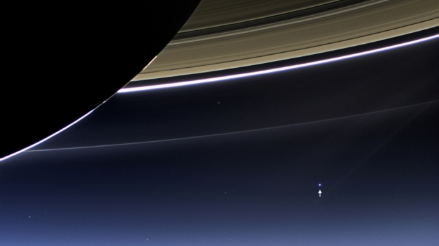 Earth (arrow) as photographed by NASA's Cassini Spacecraft with Saturn's rings in foreground, July 19, 2013/NASA, JPL-Caltech, Space Science Institute