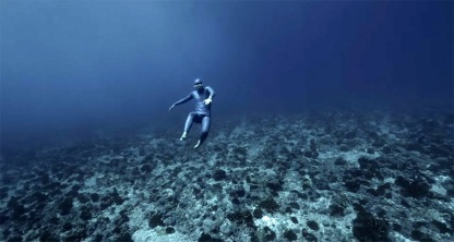 Freediver Guillaume Nery carried by swift ocean currents off Tahiti, undated/still image from video by Christopher Jobson, ThisIsCollosal.com/click to see more