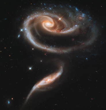 2 spiral galaxies combine / NASA, ESA, CBSNews.com / Click for more.