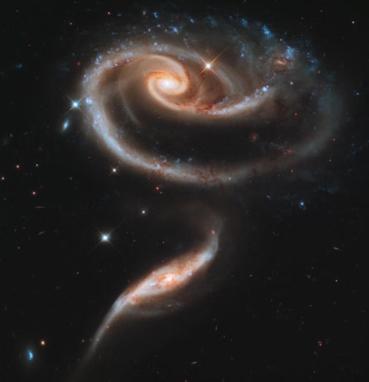 2 spiral galaxies combine / NASA, ESA, CBSNews.com / Click for more.