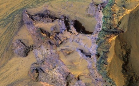 Bedrock revealed by landslide on Mars, undated / NASA, JPL-CalTech, U. of Arizona, COSMOS / Click for more.