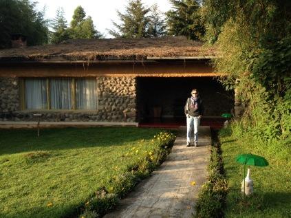 Gini outside our cottage, early morning, Gorilla Mountain View Lodge, Kinigi