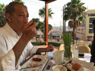 Marc enjoys a big breakfast, Le Petit Village, Kampala