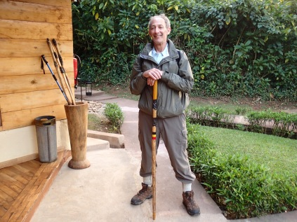 Marc selects his trusty walking stick for his second gorilla trek, Sanctuary Gorilla Forest Camp, Bwindi Impenetrable National Park