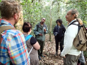 Our guide, Moses, giving us an orientation at start of chimpanzee trek with Miss Chatterbox to his left, Kibale Forest NP