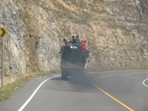 One of many black-exhaust-belching trucks, road to Lake Bunyonyi