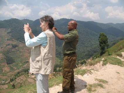 Gini and Kenneth photographing valley view, road to Bwindi