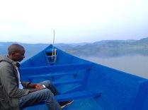 Justus, our bird guide during morning motorized canoe ride on Lake Bunyonyi