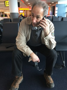 Marc in his trekking boots at JFK, waiting to board KLM flight to Amsterdam