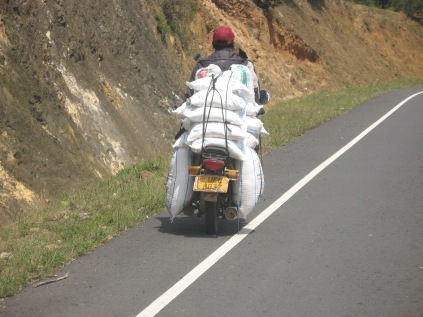 One of innumerable overloaded motorbikes, road to Lake Bunyonyi