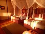 Setting sun lights our room, Crater Safari Lodge, Lake Nyinabulitwa
