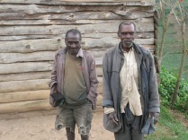 Batwa men generously permit us to take their photograph during vista stop, road to Lake Bunyonyi