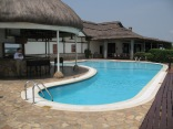 Gini on pool deck, Mweya Safari Lodge, Queen Elizabeth NP