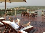 Marc reading on pool deck, Mweya Safari Lodge, Queen Elizabeth NP